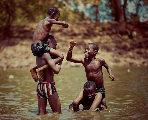 boys having fun in lake